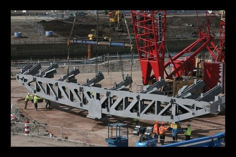 The team prepares to lift the first truss into position on the wall pictured in the top photograph
